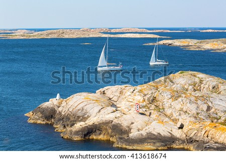 View of rocky sea archipelago with sailboats - stock photo