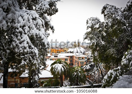 View of Rome from Villa Borghese gardens, Italy. The rare cold leaves the Italian city Rome blanketed with snow. - stock photo