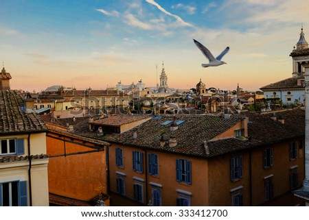 View of Rome rooftops at sunset - stock photo