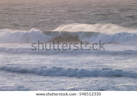 View of rough shoreline waves in the region of Odeceixe, Portugal.