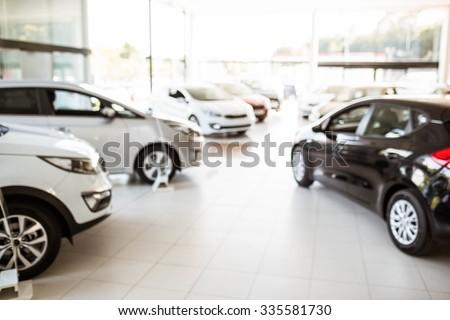 View of row new car at car dealership - stock photo