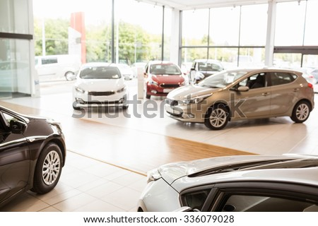 View of row new car at new car showroom - stock photo