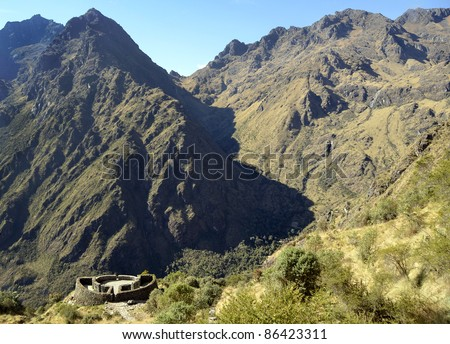 View of Runkuracay Ruins with Andes Moutain Range on the Inca Trail hike to Machu Picchu sacred Incan City