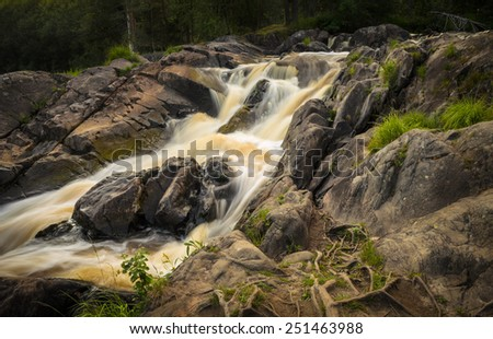view of running river cascades - stock photo