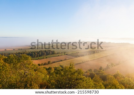 View of rural landscape in misty morning - stock photo