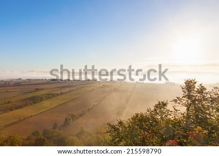 View of rural landscape in misty morning light - stock photo