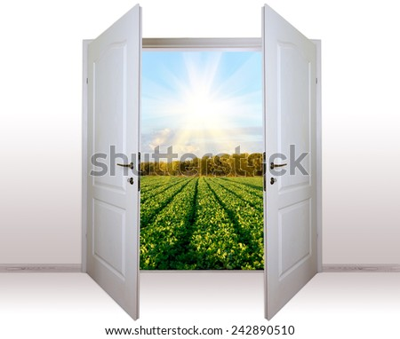 view of rural landscape through open door - stock photo