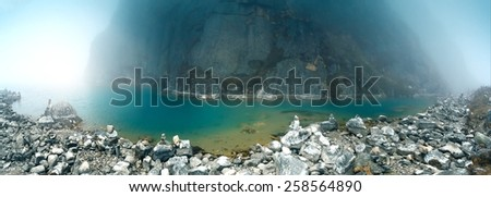 View of sacred Gokyo lake on Gokyo/Everest Base Camp trek, Everest Region, Nepal. - stock photo