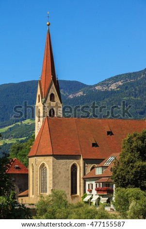 View of Saint Andreas Catholic church in the center of Chiusa, Northern Italy