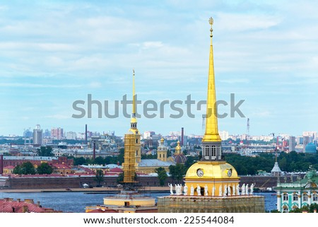 View of Saint Petersburg, Russia. Gilded spire of the Admiralty, and Saints Peter and Paul Cathedral in the background. - stock photo