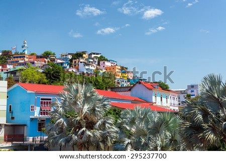 View of Santa Ana hill with palm trees in the foreground in Guayaquil, Ecuador - stock photo