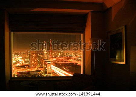 View of Sao Paulo city in Brazil seen from inside a hotel room at night. - stock photo