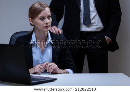 View of scared woman and self-confident boss - stock photo