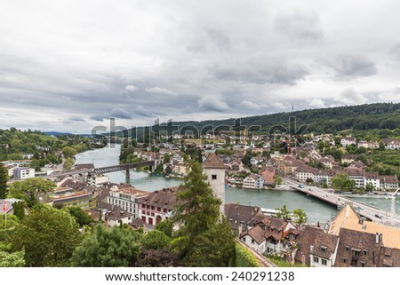 View of Schaffhausen old town and the Rhine river on a cloudy day from the Munot fortress, Switzerland - stock photo
