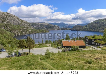 View of sea and mountains from entrance to Pulpit Rock in Norway - stock photo