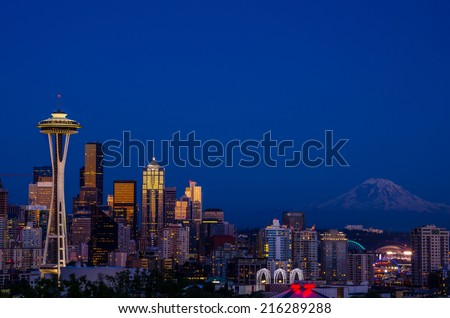 View of Seattle and Mount Rainier at Night - stock photo