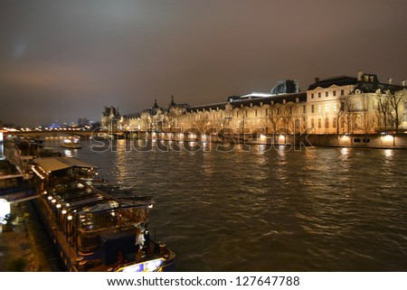 View of Seine River in nighttime Paris, France.