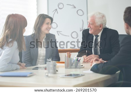 View of senior boss during business meeting - stock photo