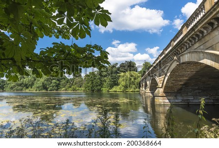 View of Serpentine Lake and Serpentine Bridge in Hyde Park in the summer, London, UK  - stock photo