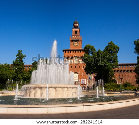 View of Sforzesco castle and fountain in Milan - stock photo