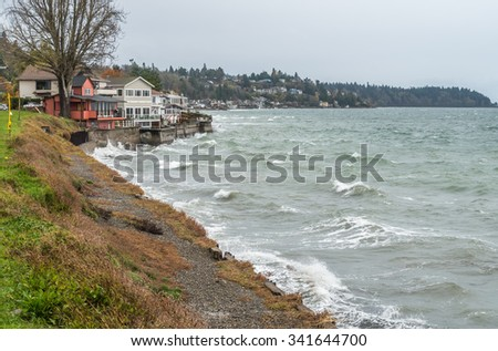 View of shoreline homes in West Seattle, Washington on a stormy day.