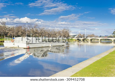 View of sightseeing cruise boat on the Yarra River in Melbourne during daytime - stock photo