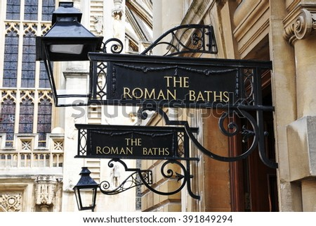 View of Signs at the Entrance of the Historic Roman Baths in the City of Bath in Somerset England - stock photo