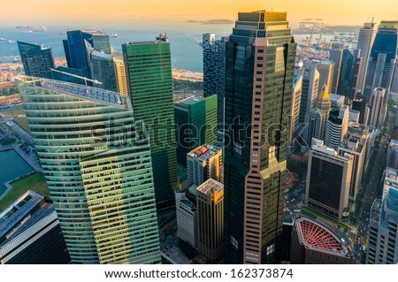 View of Singapore city skyline at sunset.  - stock photo