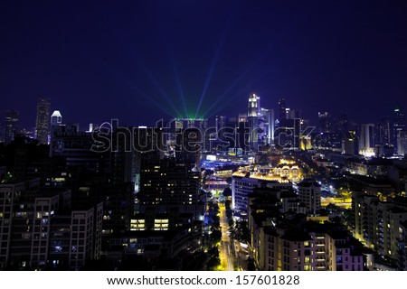 View of Singapore cityscape at night, with lightshow - stock photo