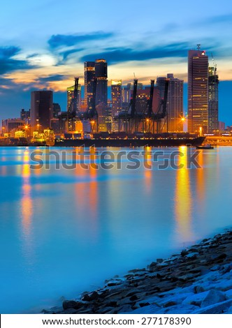 View of Singapore container port at sunset - stock photo