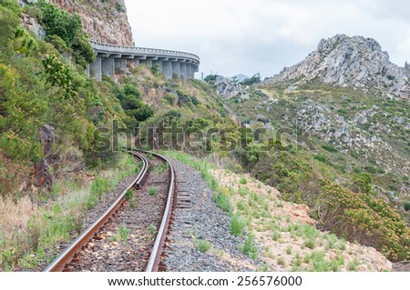 View of Sir Lowreys Pass in the Hottentots-Holland mountains near Somerset West, South Africa. The old, unused railroad is visible. 