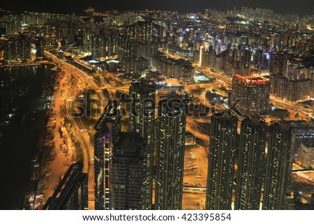 View of Skyline of Hong Kong, Kowloon area after sunset from Sky 100 - stock photo