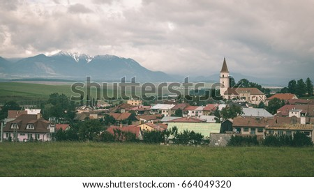 view of small country town. village scenes - vintage green effect