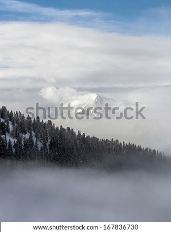 View of snow-covered mountains of a valley of Zillertal in foggy weather - Mayrhofen, Austria - stock photo