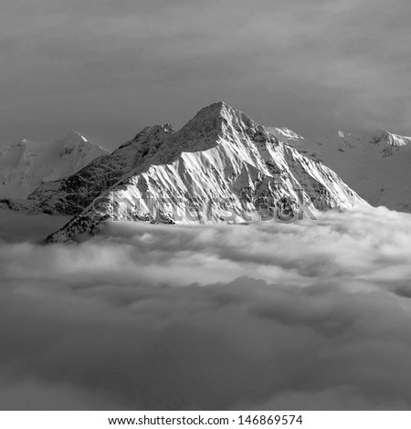 View of snow-covered mountains of a valley of Zillertal - Mayrhofen region, Austria (black and white) - stock photo