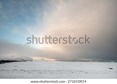 View of snow covered mountains, plains and beaches in southern Iceland during a winter morning. - stock photo