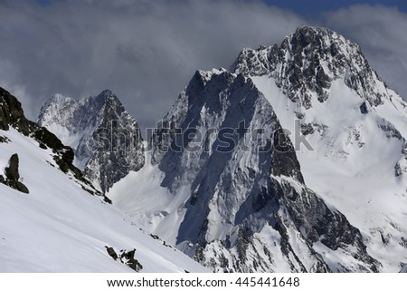 View of Snow Mountain Range Landscape with Blue Sky. Russia, Caucasus.