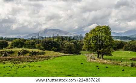 View of Snowdonia in Wales with Mountains in the distance - stock photo