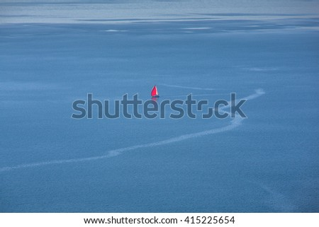 View of  solitary red sailboat on the adriatic sea - stock photo
