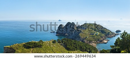 view of Somaemuldo island lighthouse and nearby islands from mountain top on sunny day, South Korea - stock photo