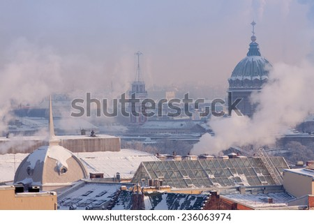 View of St. Petersburg from the colonnade of St. Isaac's Cathedral on the dome of the Kazan Cathedral and the Tower City Council - stock photo