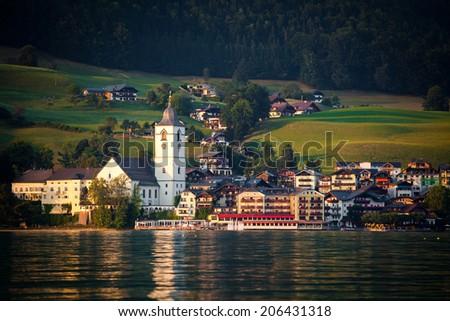 View of St. Wolfgang village waterfront at Wolfgangsee lake at sunset, Austria - stock photo