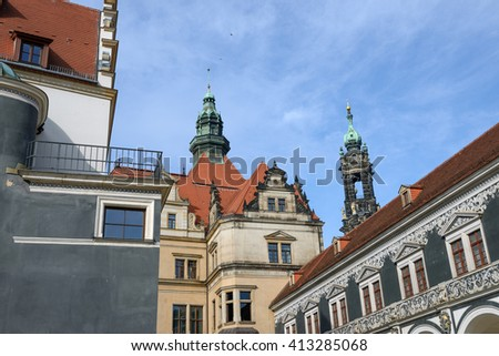 View of Stables Courtyard (Stallhof) from corner of Chancellery Building toward George Gate and top of bell tower of Dresden Cathedral, Saxony, Germany.