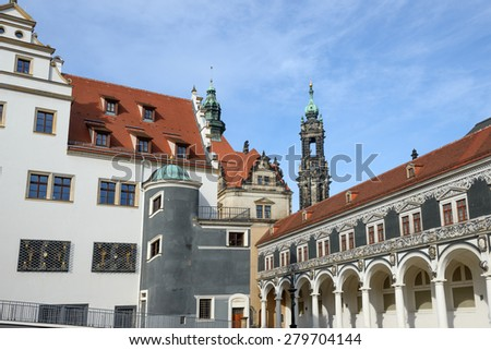 View of Stables Courtyard (Stallhof) toward Chancellery Building, George Gate and top of bell tower of Dresden Cathedral, Saxony, Germany. - stock photo
