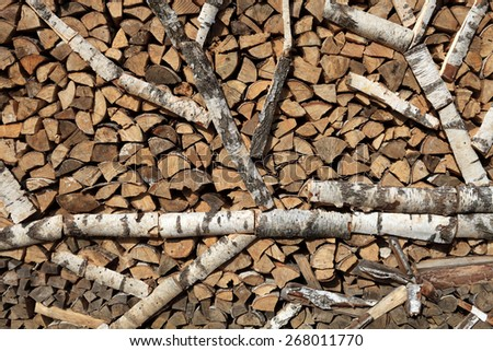 View of stack of firewood as background - stock photo