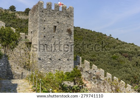 view of stone tower on walls of ancient village on a sunny spring day, Portovenere, Italy - stock photo