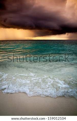 View of storm seascape in Maldives - stock photo