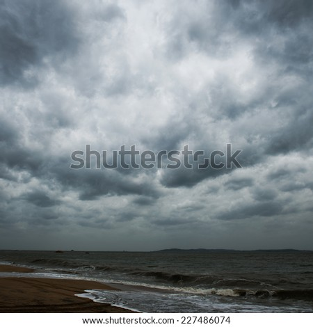View of storm seascape with dark clouds. - stock photo