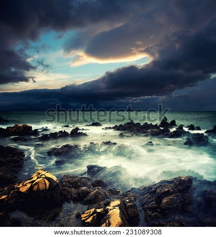 View of storm seascape with dramatic sea and sky - stock photo