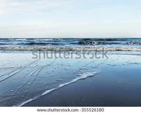 View of storm seascape with moody clouds. - stock photo